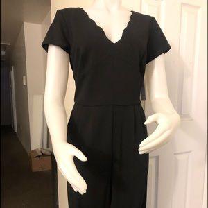 All black elegant jumpsuit .